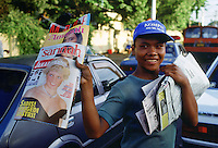 Boy sells magazines, in Jakarta, Indonesia