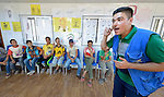 Boys discuss conflict resolution as part of a psycho-social program run by the Lutheran World Federation in the Zaatari refugee camp near Mafraq, Jordan. Established in 2012 as Syrian refugees poured across the border, the camp held more than 80,000 refugees by early 2015, and was rapidly evolving into a permanent settlement. The Lutheran World Federation is a member of the ACT Alliance, which provides a variety of services to refugees living in the camp.