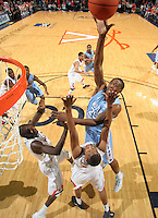 Jan. 8, 2011; Charlottesville, VA, USA;  North Carolina Tar Heels forward Justin Knox (25) shoots over Virginia Cavaliers center Assane Sene (5) and Virginia Cavaliers forward Akil Mitchell (25) during the game at the John Paul Jones Arena. North Carolina won 62-56. Mandatory Credit: Andrew Shurtleff