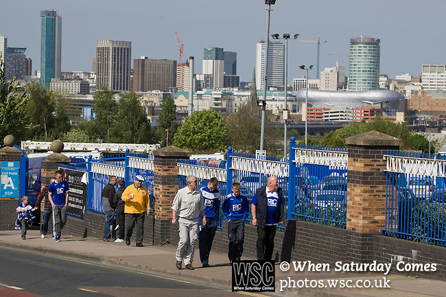Birmingham City 1 Wolverhampton Wanderers 1, 01/05/2011. St Andrews, Premier League. Fans walking up Cattall Road towards St. Andrew's stadium with the city's skyline in the distance, prior to Birmingham City's Barclay's Premier League match with Wolverhampton Wanderers. Both clubs were battling against relegation from  England's top division. The match ended in a 1-1 draw, watched by a crowd of 26,027. Photo by Colin McPherson.