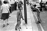 Arabs London UK 1977. Middle Eastern people came to Britain for subsidised health care in Harley Street clinics. They mainly stayed in cheap hotels in Earls Court. Middle Eastern children playing in the street.