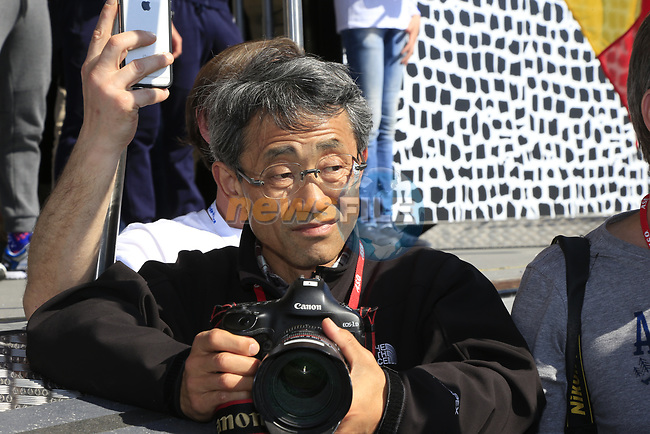 Photographer Yuzuru Sunada at the Team Presentation for the upcoming 115th edition of the Paris-Roubaix 2017 race held in Compiegne, France. 8th April 2017.<br /> Picture: Eoin Clarke | Cyclefile<br /> <br /> <br /> All photos usage must carry mandatory copyright credit (&copy; Cyclefile | Eoin Clarke)