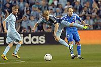 Seth Sinovic (15) defender Sporting KC gets in front of Justin Mapp (21) midfield Montreal..Sporting Kansas City defeated Montreal Impact 2-0 at Sporting Park, Kansas City, Kansas.