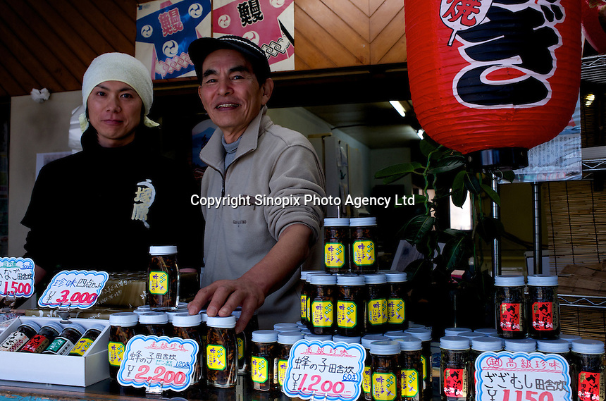 Mr Tsukahara poses in his shop that specializes in selling insects, Ina City, Nagano Prefecture, Japan.