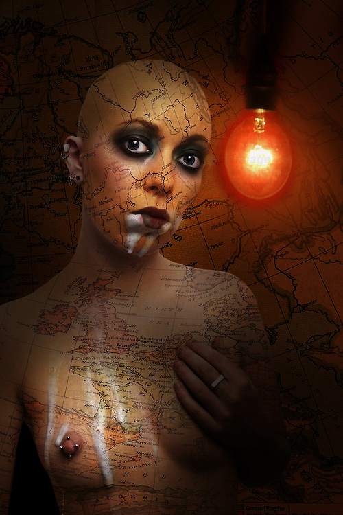 A naked young woman with a shaved head standing beside a red light bulb overlaid with a map
