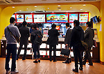 People at McDonalds fast food restaurant counter Tokyo, Japan.