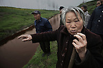 Villagers who live along the Hong River complain about sewage that is dumped into the river by industries along the river. Xiping county, Henan Province, April 2, 2009