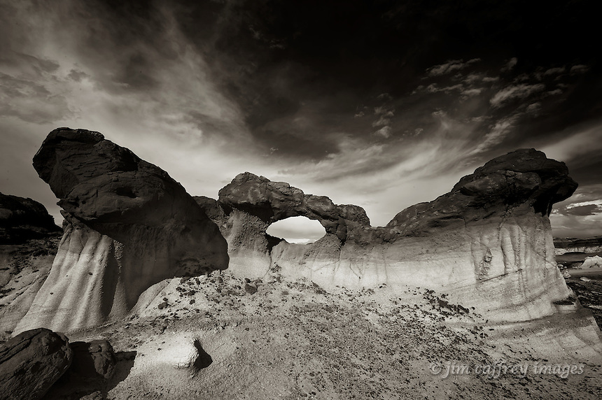 A sepia toned image of the Bisti Arch in the Bisti Wilderness in the San Juan Basin of northwest New Mexico.