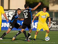 Guillermo Barros Schelotto of the Crew dribbles the ball away from Earthquakes' Jason Hernandez and Ramiro Corrales during the game at Buck Shaw Stadium in Santa Clara, California.  San Jose Earthquakes tied Columbus Crew, 2-2.