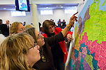 Feb. 25, 2013 - Mineola, New York, U.S. - AUDREY CIUFFO (front) of Merrick, and JOANNE FARLEY (red jacket) of Great Neck League of Woman Voters, are among those looking at the controversial proposed Redistricting Map, during a short recess at the Nassau County Legislature meeting. The legislature postponed the vote on the map shortly before 1 AM the morning of February 26, nearly 12 hours after the meeting started on 1:30 PM Feb. 25.