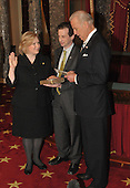 Washington, DC - January 27, 2009 -- United States Senator Kirsten Gillibrand (Democrat of New York), left  recreates her swearing-into office with United States Vice President Joseph Biden in the Old Senate Chamber of the United States Capitol in Washington, D.C. on Tuesday, January 27, 2009.  Her husband Jonathan holds the Bible..Credit: Ron Sachs / CNP.(RESTRICTION: NO New York or New Jersey Newspapers or newspapers within a 75 mile radius of New York City)