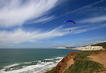 Paragliding along the south west coast of the isle of wight, above Compton Bay looking towards tennyson down and the needles beyond