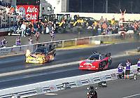 Feb 13, 2016; Pomona, CA, USA; NHRA funny car driver Jim Campbell (left) alongside Gary Densham during the Winternationals at Auto Club Raceway at Pomona. Mandatory Credit: Mark J. Rebilas-USA TODAY Sports