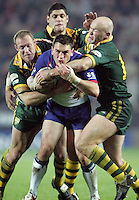 Pix by JOHN CLIFTON/SWpix.com - Gillette Tri-Nations Tournament 2005, Great Britain v Australia, Game Six, The KC Stadium, Hull ...19/11/05..Picture Copyright >> Simon Wilkinson >> 07811267706..Great Britain's Kevin Sinfield is tackled by 3 Australian players