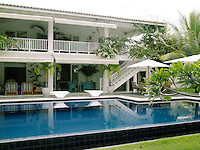 The veranda and terraces of this contemporary beach house open onto a tranquil swimming pool