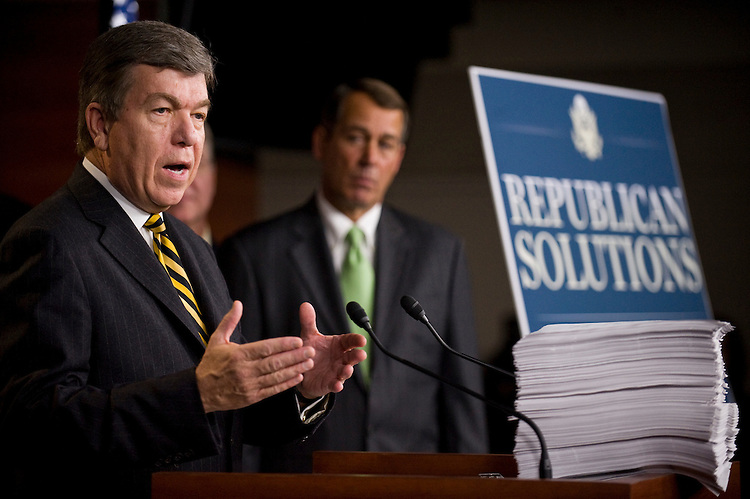 "WASHINGTON, DC - Oct. 29: Rep. Roy Blunt, R-Mo., House Minority Leader John A. Boehner, R-Ohio, during a news conference on the unveiling of the long-awaited House Democratic health care overhaul package, known as the ""Affordable Health Care for America Act."" The nearly 2,000-page legislation (HR 3962) - on the podium in front of Blunt - is expected to be on the House floor late next week. Early indications were that Democrats across the ideological spectrum were lining up behind the main health care measure, which was assembled by Speaker Nancy Pelosi, D-Calif., and her team. Republicans, as expected, uniformly denounced the legislation. Not a single GOP member is expected to vote for it. (Photo by Scott J. Ferrell/Congressional Quarterly)"