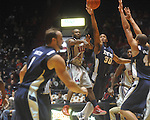"Ole Miss guard Chris Warren (12)  passes as East Tennessee State's Micah Williams (30) defends at the C.M. ""Tad"" Smith Coliseum in Oxford, Miss. on Saturday, December 18, 2010."