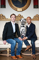 Gaspard, the Dalmation poses on the couch between Michel Lasserre and Hassan Abdullah