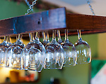 Clean glasses hang over the bar in the tasting room at General's Ridge Vineyard and Winery.