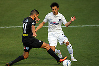 Mario Barcia controls the ball under pressure from Takuya Iwata during the Oceania Football Championship final (second leg) football match between Team Wellington and Auckland City FC at David Farrington Park in Wellington, New Zealand on Sunday, 7 May 2017. Photo: Mike Moran / lintottphoto.co.nz