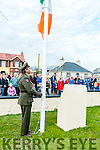 Moyvane Village Festival: Commadent Raymond McGibney, staff officer Collins Barracks raising the tricolour at the official opening of the 365th 1916th Garden of Remembrance at Moyvane on Sunday last.