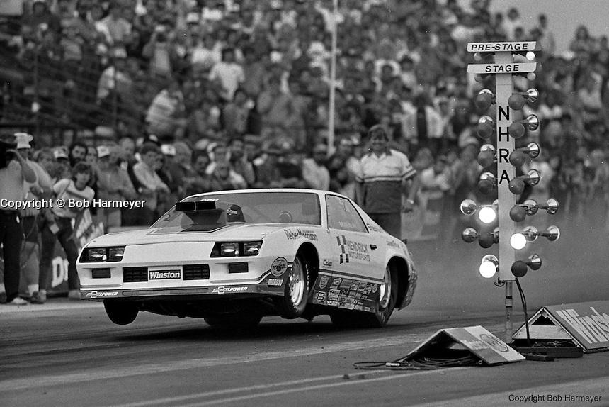 POMONA, CALIFORNIA: Bruce Allen drives the Reher-Morrison Pro Stock Camaro during during a 1985 NHRA drag race at Pomona, California.