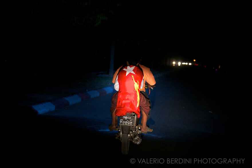 A lonely motorbike, late at night heads home after the celebrations. Burma is on the verge of a long waited era aiming to a democratic progression.