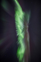 The northern lights burst into a coronal display during a display of high activity in March of 2013. Aurora corona as seen when standing directly below a bundle of parallel plasma-channeling magnetic field lines that are converging on a point high in the sky. Alaska's Brooks range, Arctic, Alaska
