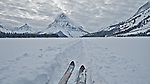 glacier national park, ski tracks on frozen two medicine pake, sinopah mountain, glacier national park, montana