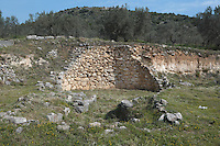 MYCENAE, GREECE - APRIL 13 : A general view of a tomb on April 13, 2007 in Mycenae, Peloppenese, Greece. Mycenae, a hill top citadel and palace complex, was the most important place in Greece from c. 1600 to c. 1100 BC. The site was first completely excavated by German archaeologist Heinrich Schliemann between 1874 and 1878. The tombs, or shaft graves, built in the 16th century BC, contained large amounts of gold treasure indicating that they belonged to the rulers of Mycenae. (Photo by Manuel Cohen/Getty Images)