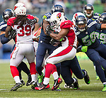 Arizona Cardinals running back Stephan Taylor (30) can't find any running room against Seattle Seahawks strong safety Kam Chancellor (31) and linebacker K.J. Wright (50) at CenturyLink Field in Seattle, Washington on November 23, 2014. The Seahawks beat the Cardinals 19-3.   ©2014. Jim Bryant Photo. All Rights Reserved.