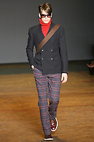 Mark walks runway in a normandy blue tommy suiting jacket, dark red fuzzy cashmere turtleneck sweater, ink blue multi beau tweed pant, and burgundy leather brogues, from the Marc by Marc Jacobs Fall/Winter 2011 collection, during New York Fashion Week, Fall 2011.