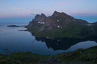 Twilight reflection of mountain peaks in Reinefjord and Forsfjord, Moskenesøy, Lofoten Islands, Norway