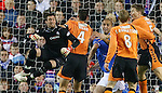 Allan McGregor charges out but clears the ball to the feet of Scott Robertson leading to Dundee Utd's third goal