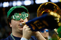 PITTSBURGH, PA - MARCH 21: A member of the Notre Dame Fighting Irish pep band performs during the third round of the 2015 NCAA Men's Basketball Tournament against the Butler Bulldogs at Consol Energy Center on March 21, 2015 in Pittsburgh, Pennsylvania.  (Photo by Jared Wickerham/Getty Images)