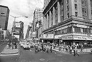 May, 1980. Manhattan, New York City, NY. Times Square street corner. Traffic is heavy and chaotic.<br /> <br /> Manhattan, New York City, NY. Mai, 1980. Times square &agrave; la 43eme rue. Le trafic est intense 24 heures sur 24 et les encombrements sont incessants.