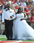 Homecoming Queen Courtney Pearson, right, is escorted by her father Commander Kerri Pearson during halftime of the Mississippi vs. Auburn at Vaught-Hemingway Stadium in Oxford, Miss. on Saturday, October 13, 2012. Miss Pearson is the University of Mississippi's first African-American homecoming queen. (AP Photo/Oxford Eagle, Bruce Newman)..
