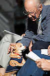 Paul Corwin pets chihuahua Ponchy before the start of the service to bless the animals.