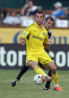 WASHINGTON, DC - AUGUST 4, 2012:  Daniel Woolard (21) of DC United pushes into Justin Meram (9) of the Columbus Crew during an MLS match at RFK Stadium in Washington DC on August 4. United won 1-0.