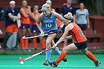 12 September 2014: North Carolina's Nina Notman (GER) (10) and Syracuse's Serra Degnan (11). The University of North Carolina Tar Heels hosted the Syracuse University Orange at Francis E. Henry Stadium in Chapel Hill, North Carolina in a 2014 NCAA Division I Field Hockey match. UNC won the game 3-0.