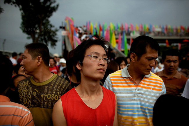 Locals and foreigners try to buy Olympic tickets but scalpers are asking for more than a 700 percent profit in Beijing, China on Sunday, August 17, 2008.  Kevin German
