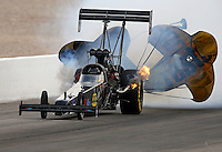 Mar 29, 2014; Las Vegas, NV, USA; Pieces of bodywork fly off the car off NHRA top fuel dragster driver Scott Palmer during qualifying for the Summitracing.com Nationals at The Strip at Las Vegas Motor Speedway. Mandatory Credit: Mark J. Rebilas-