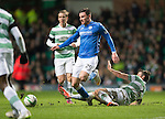 Celtic v St Johnstone.....04.03.15<br /> Michael O'Halloran is tackled by Adam Matthews<br /> Picture by Graeme Hart.<br /> Copyright Perthshire Picture Agency<br /> Tel: 01738 623350  Mobile: 07990 594431