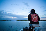 Crystal Greene from Winnipeg and Shoal Lake  fishes on Shoal Lake in Manitoba at dusk. Ms. Greene is a activist that is dedicating her time to stopping the Energy East pipeline. (Credit: Robert van Waarden - http://alongthepipeline.com)