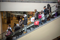 Christmas shoppers in the Queens Center Mall in the borough of Queens in New York on Sunday, December 15, 2013 looking for bargains. A study by the National Retail Federation says that $600 billion in hoilday purchases will be made by Americans, accounting for 19.3% of all retail sales. (© Richard B. Levine)