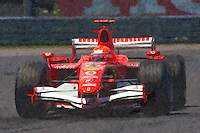 Michael Schumacher of Scudera Ferrari exits the Senna complex of turns 1 and 2 during the 2006 Canadian F1 Grand Prix at Circuit Gilles-Villeneuve in Montreal, Canada