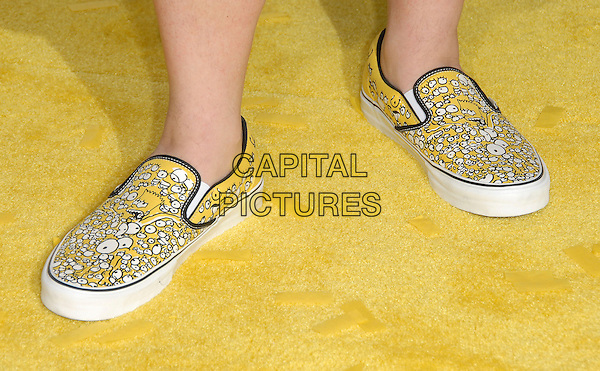 "KEVIN SMITH'S SHOES.at The Twentieth Century Fox L.A. Premiere of ""The Simpsons Movie"" held at The Mann Village Theatre in Westwood, California, USA, July 24 2007.                                  .detail close-up plimpsoles Bart Simpson logo face yellow and white patterned print sneakers  trainers.CAP/DVS.©Debbie VanStory/Capital Pictures"