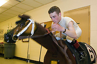 27 May 2006 - ELMONT, NY - 22 year-old French apprentice jockey Julien Leparoux warms up on a wooden training horse in the jockeys' room at Belmont Park hippodrome in Elmont, outside New York City, USA, 27 May 2006.