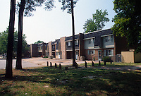 1992 May 01..Assisted Housing..N. Wellington Place.Wellington Oaks Exteriors.Looking at Wellington Street from the woods..CAPTION...NEG#.NRHA#..HOUSING:WelOak 1 1:18