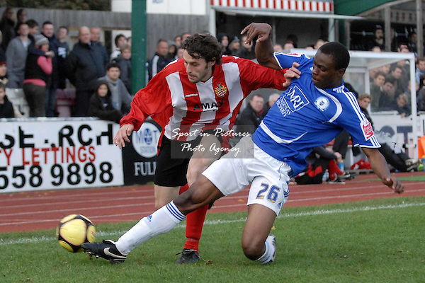 Gabriel Zakuani (Peterborough United) tackles Simon Parker (AFC Hornchurch). AFC Hornchurch Vs Peterborough United. FA Cup 1st round. The Stadium. Upminster. 09/11/08 Credit Garry Bowden